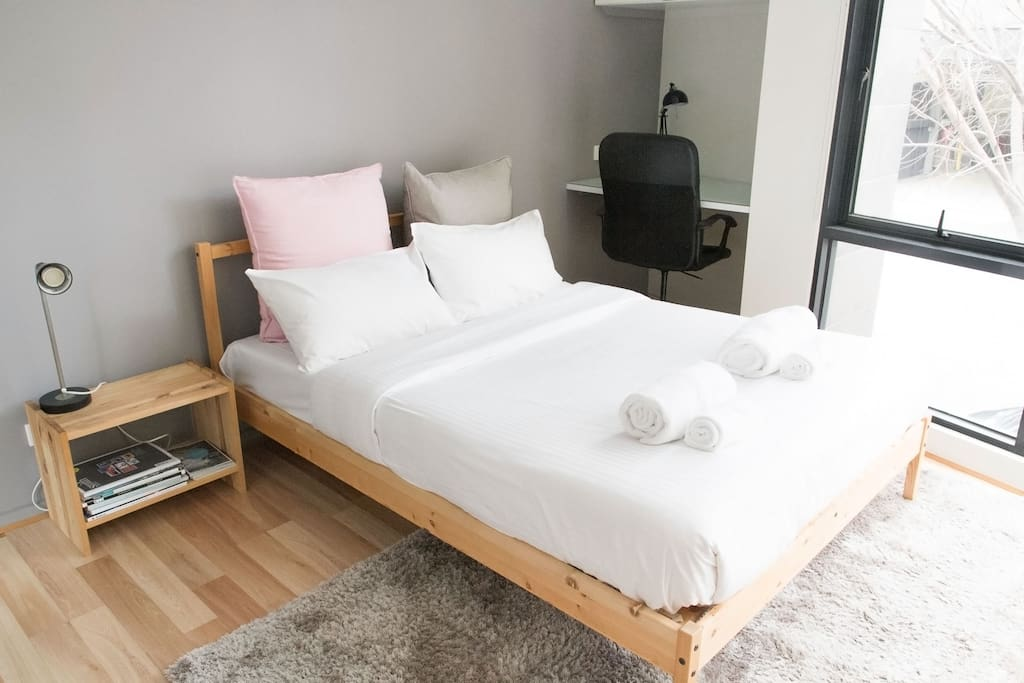 Comfortable double bed with hotel quality linens