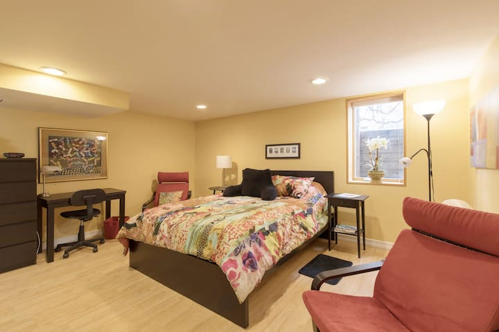 You will have a large room with a desk, comfy queen bed two chairs and bright egress window.
