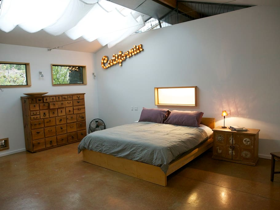 The loft  king size bed and the great reading light window.