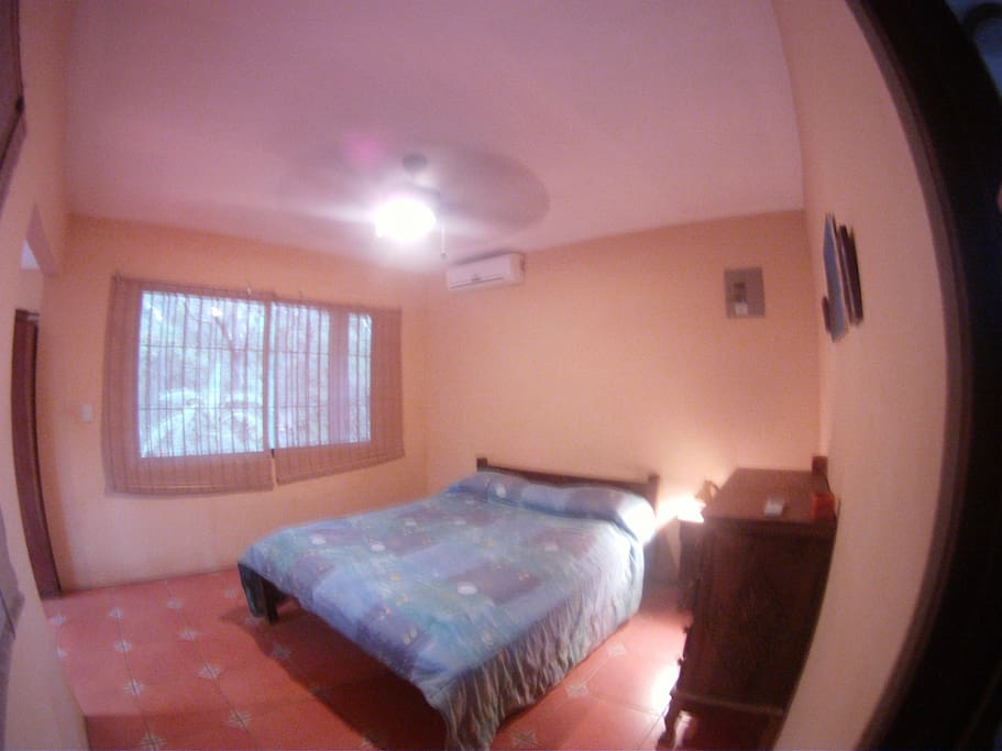 comfortable bedroom with air conditioner