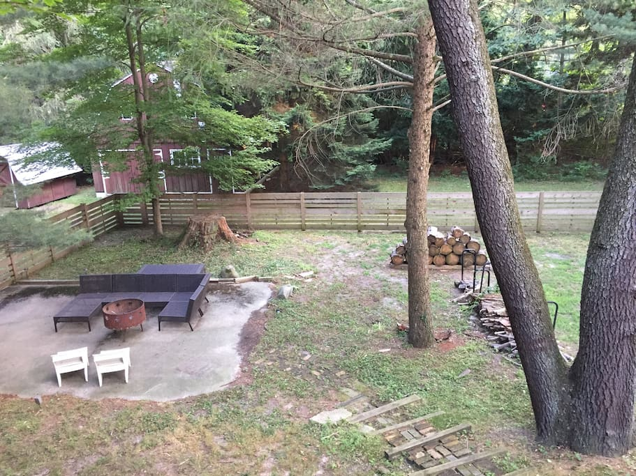 Fenced in back yard, lower patio with fire pit