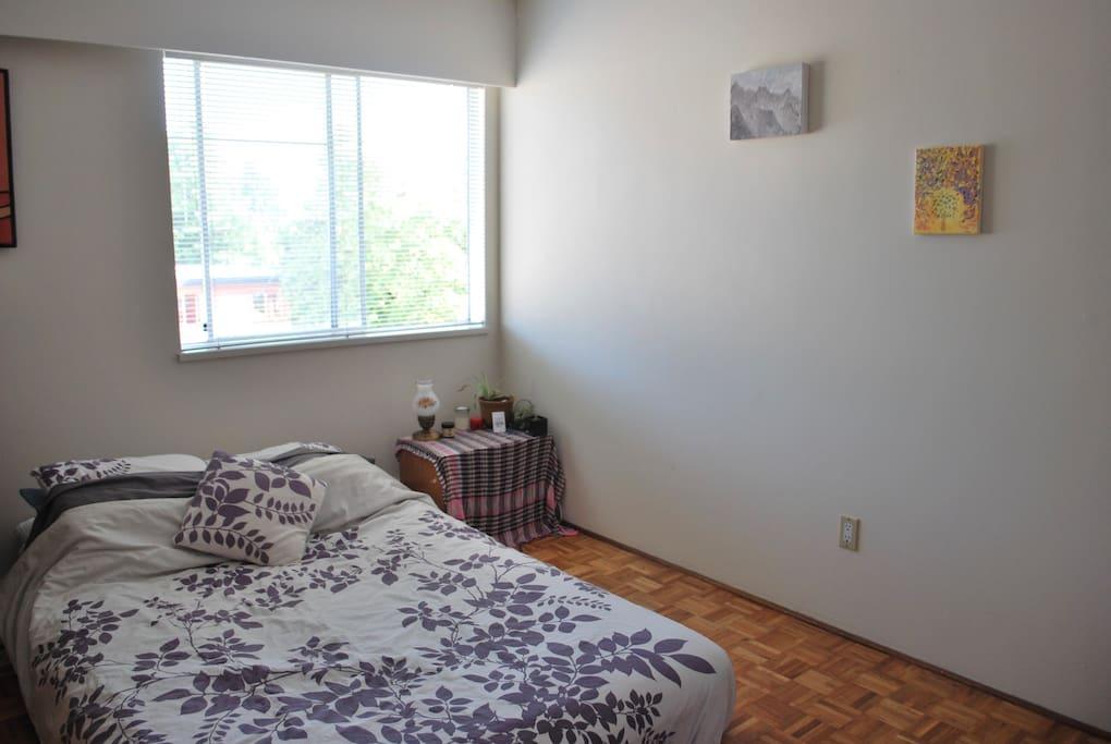 Big bedroom with comfy queen mattress.