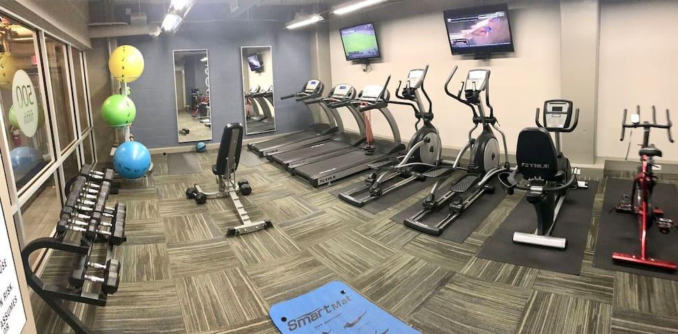 Great fitness center with full dumbbell set!