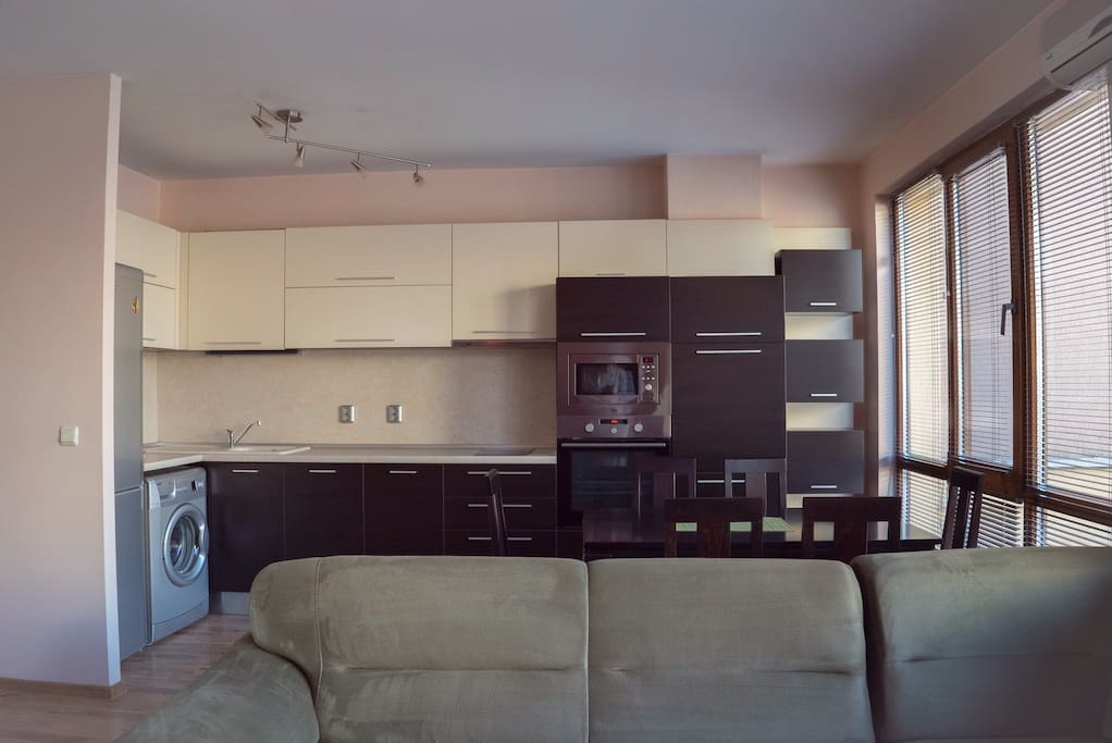 Kitchen with all appliances needed including dishwasher, microwave, espresso machine