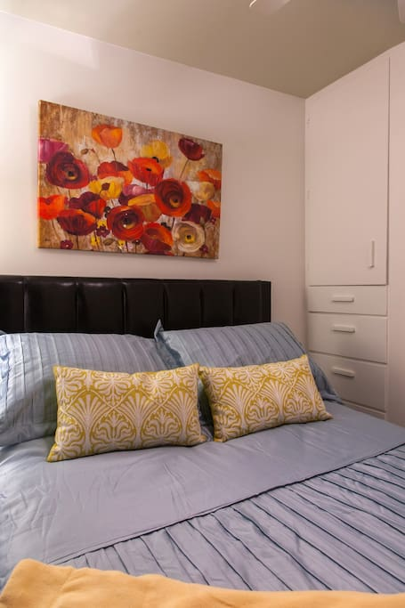 In addition to the double bed, there is also a built-in cabinet and dresser.