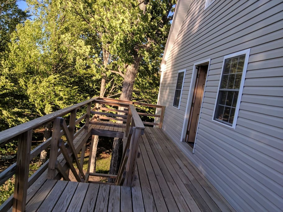 We are on the upper deck of the back of the house where there is a private entrance.