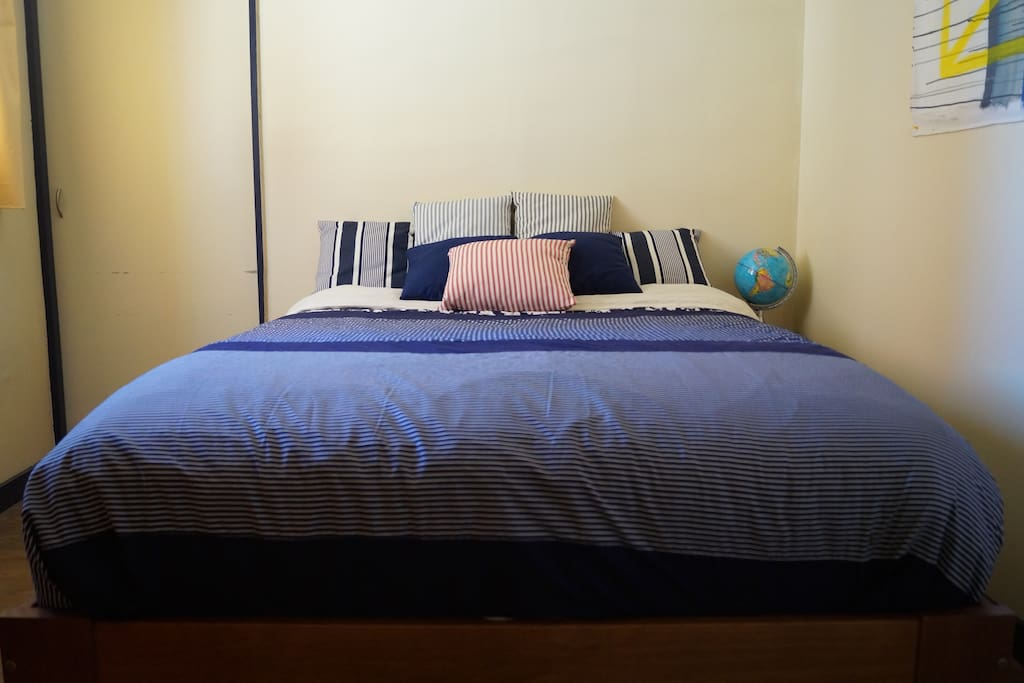 Bedroom with one queen size bed with fresh quality sheeting, down duvet and hotel quality towels