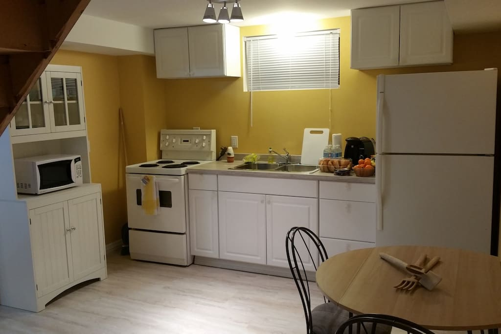 Bright spacious full service  kitchen to start or end your day.