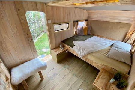 Cosy caravan with private bathroom and garden.