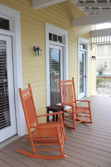 The large covered front porch is perfect for enjoying your morning coffee.. or afternoon cocktail!