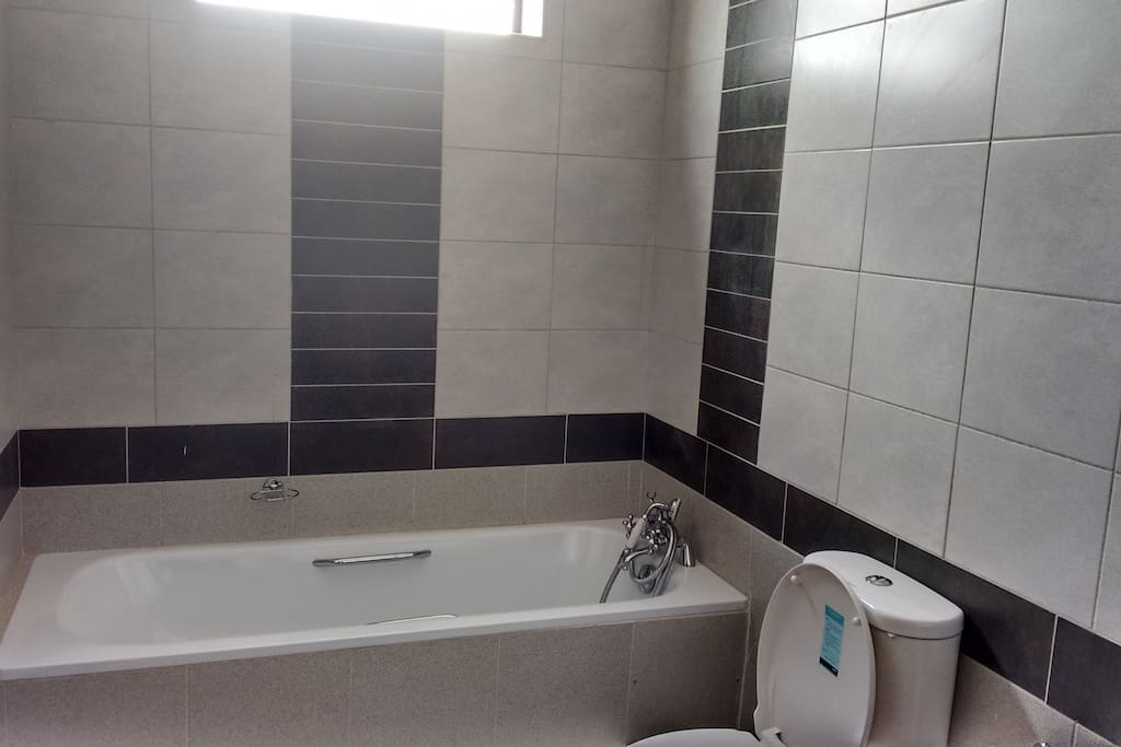 Master bedroom bathroom with tub