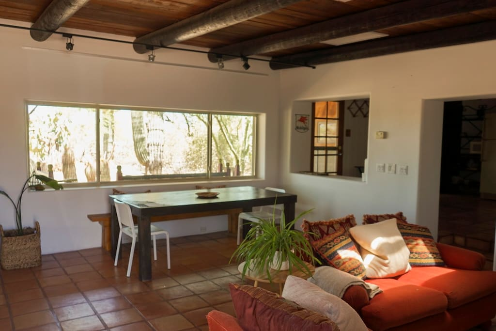Dining area with a large wood table, perfect for enjoying a meal watching the desert wildlife outside!
