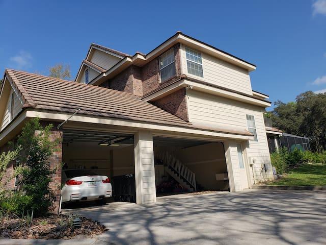 Large drive way + 3 car garage  + outdoor amenities.