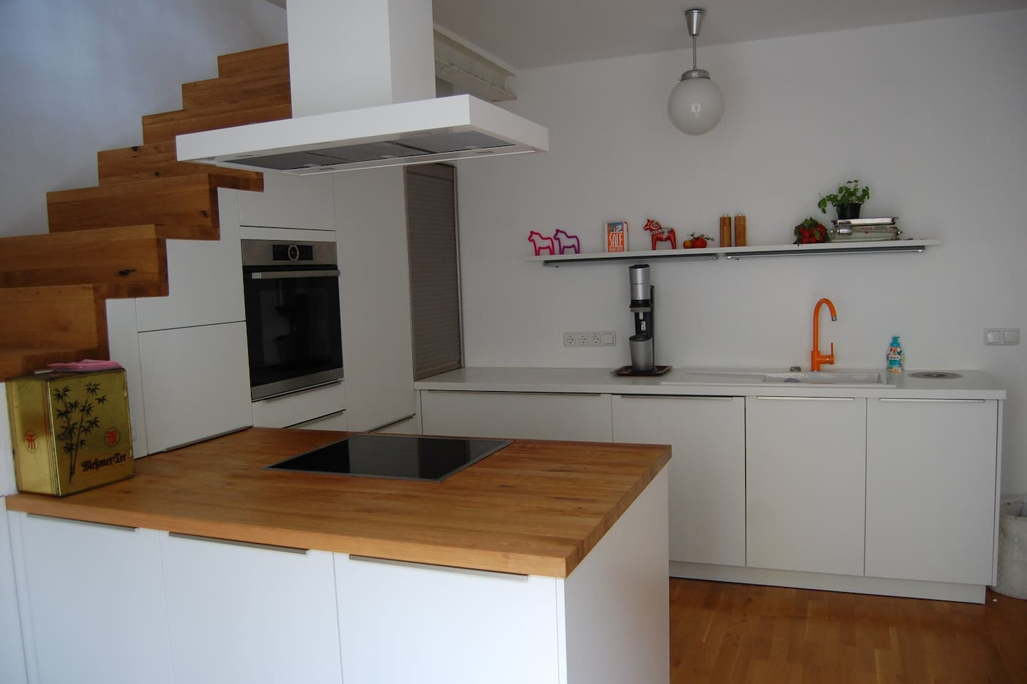 large modern kitchen in ground floor with stair case to living room in first floor