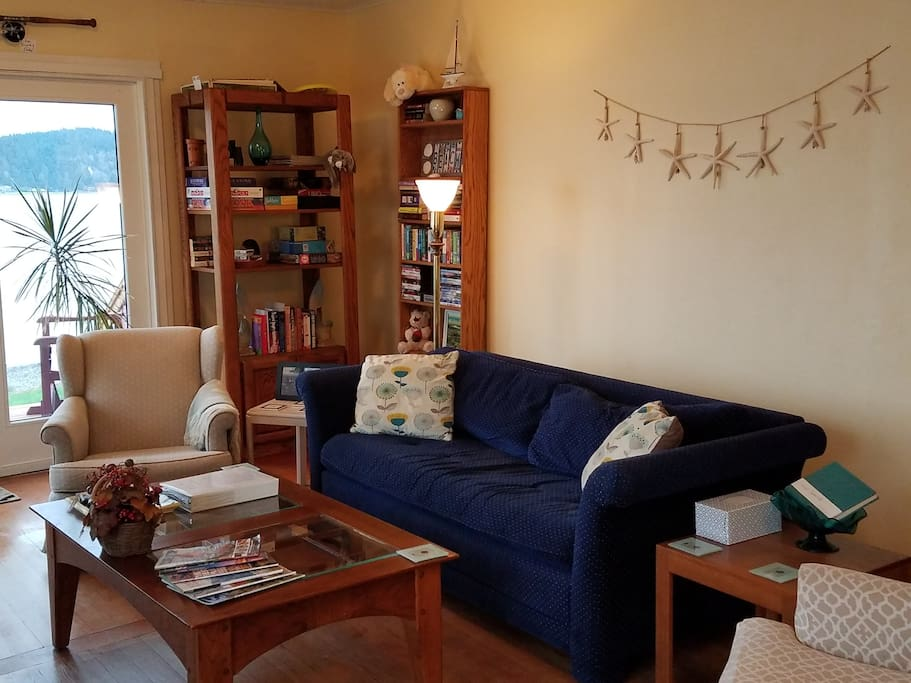 Living area includes full size sofa-bed, sleeps 2 persons. Games, books, and DVDs.