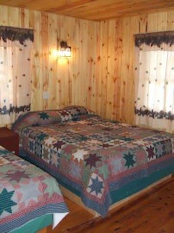 Three Pines has 1 bedroom with 2 queen beds