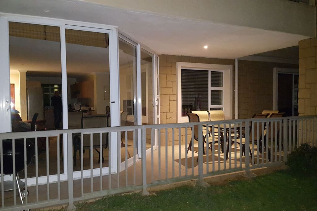 Front of house showing the outside patio and braai area.