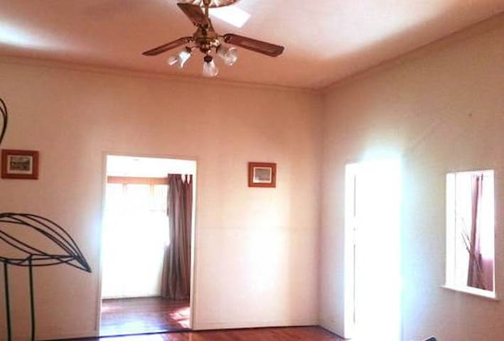 Large Living area with a Ceiling fan & Aircon