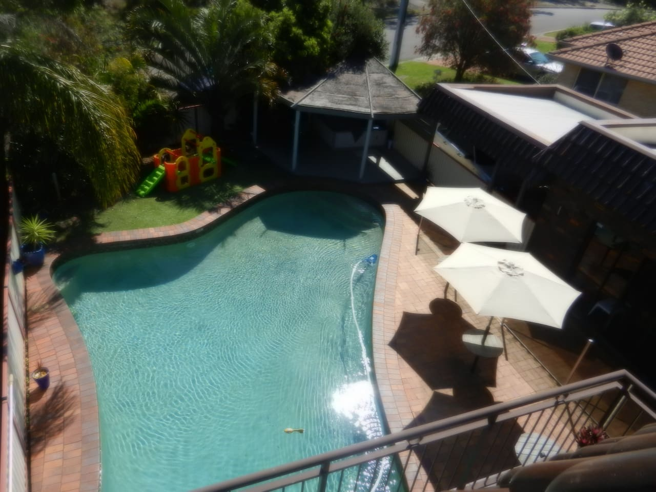 Location shot from balcony showing pool, spa and grassed area. Fun for all ages.