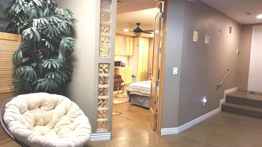 Grand room with doorway to entire SLC valley view