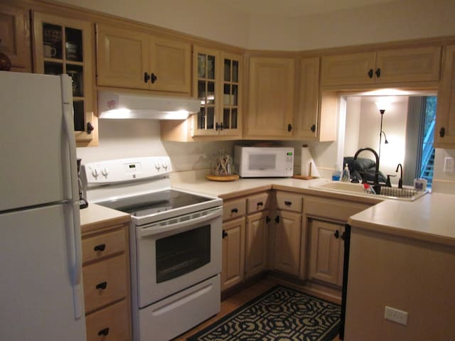 A clean, West facing, bright, private kitchen,cook & bake,full size appliances, all kitchen wares, blender, toaster, 12cup coffee maker, hand mixer, filtered water at sink, glassware, dishes, pots,pans & flatware. Open to TV room - No TV IN KITCHEN.