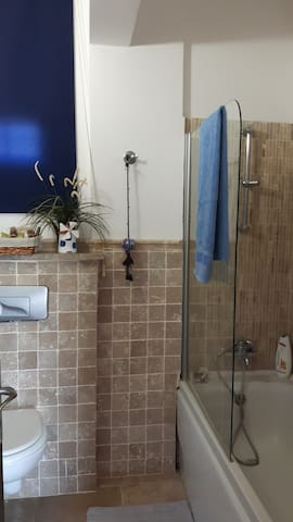 Guest bathroom with bath tab,wc and wash basin.