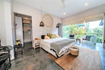 Second floor master bedroom with KING SIZE bed that can be separated into TWO SINGLES to make a TWIN ROOM if needed.  Has private ensuite, balcony overlooking pool and gardens and huge walk in dressing room/wardrobe.