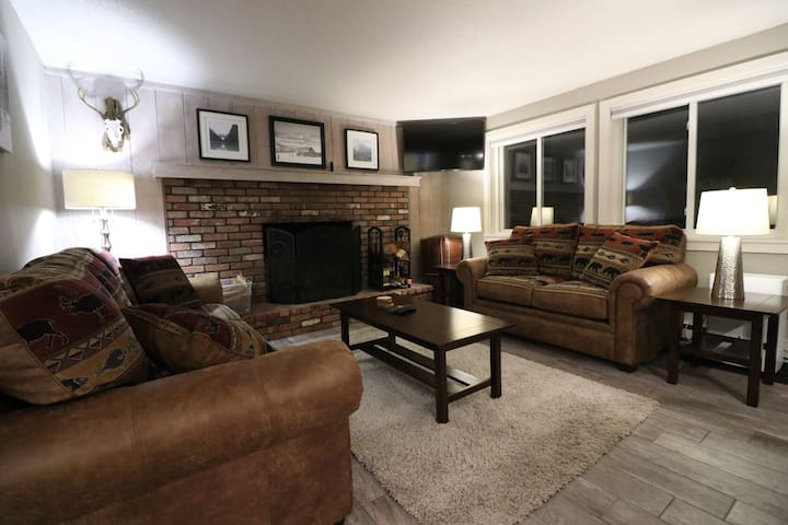 New furniture with wood burning fireplace . The large couch has a memory foam mattress