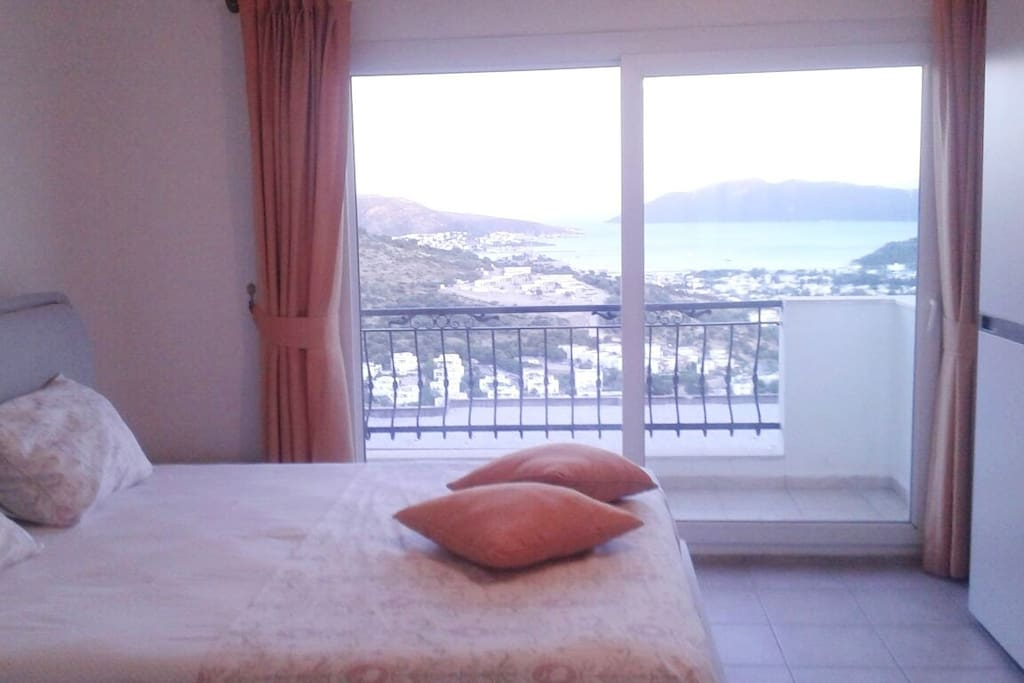 Bedroom #1 with ensuite bathroom and balcony with Bodrum's spectacular view