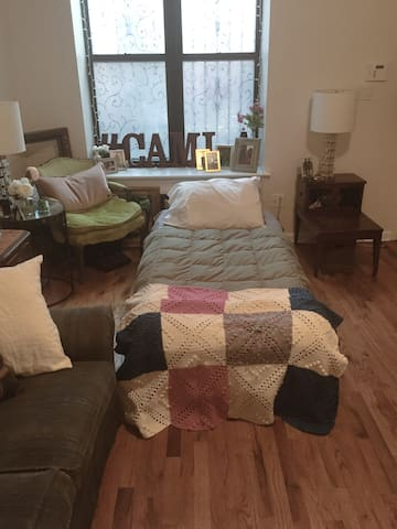 We will provide a twin or queen size air mattress or both to your choice. We provide fresh linen, and clean towels during your stay.  This is one example of a twin set up in the living room.