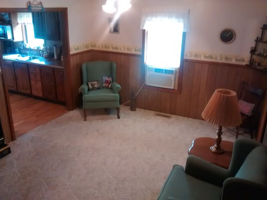 This is the guest living room the Host does not share but may walk through to kitchen.