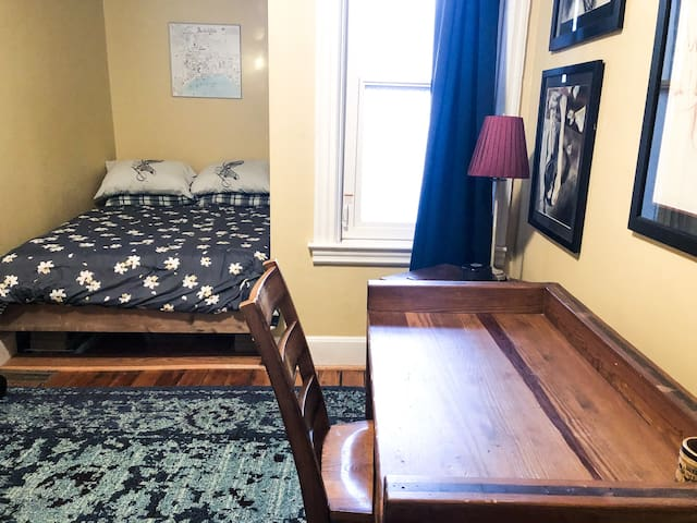 Second bedroom also contains a desk to work from home