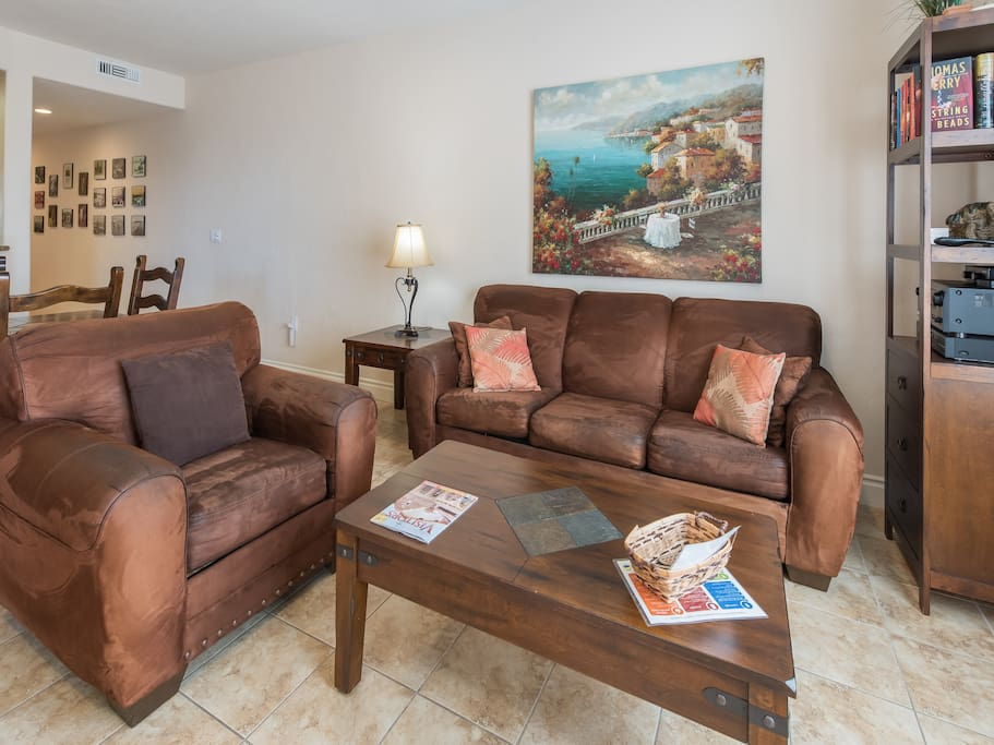 Seating for 4 in the living area. Complimentary Wi-Fi provided. The TurnKey HomeDroid tablet, an electronic guest directory, contains local suggestions and specific home details (e.g., TV instructions).