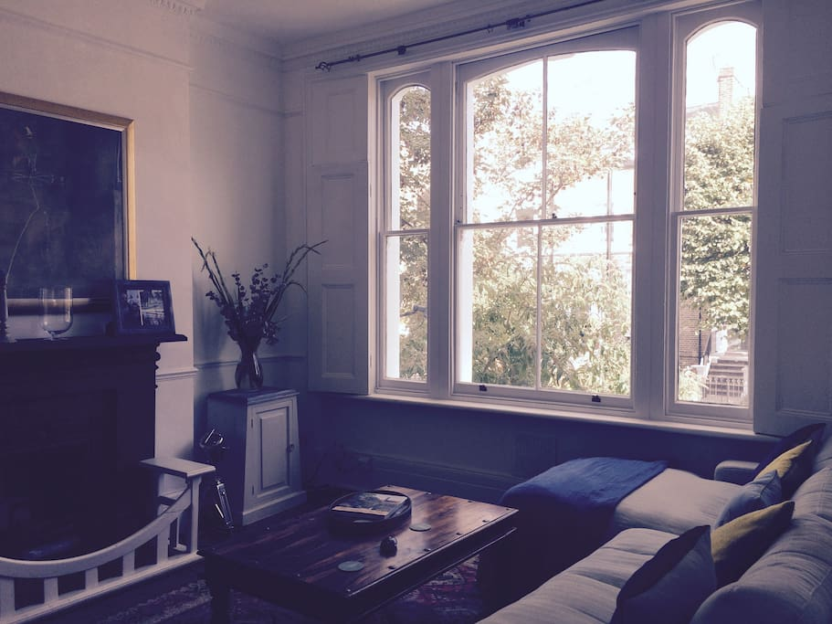 Lounge with large french windows and shutters