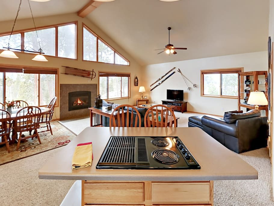 An open floor plan with vaulted ceilings and plenty of natural light creates a welcoming vibe throughout the home.