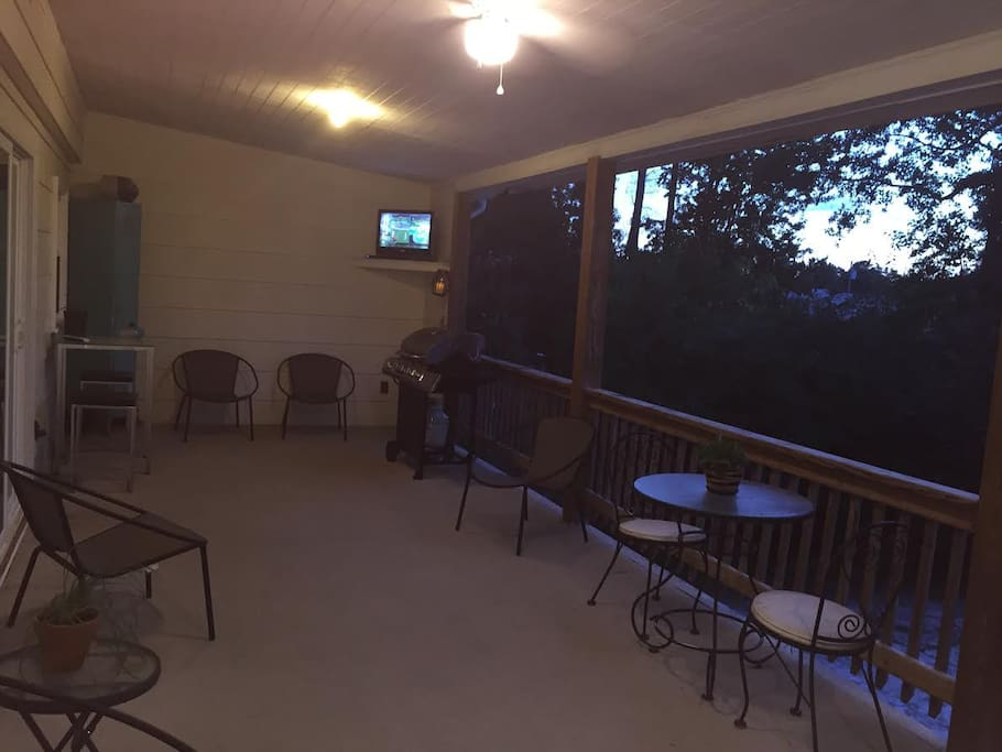 Other side of deck with cable TV, grill, locker, and tables.