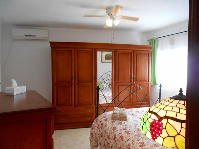 Master bedroom with air-conditioning and ceiling fan