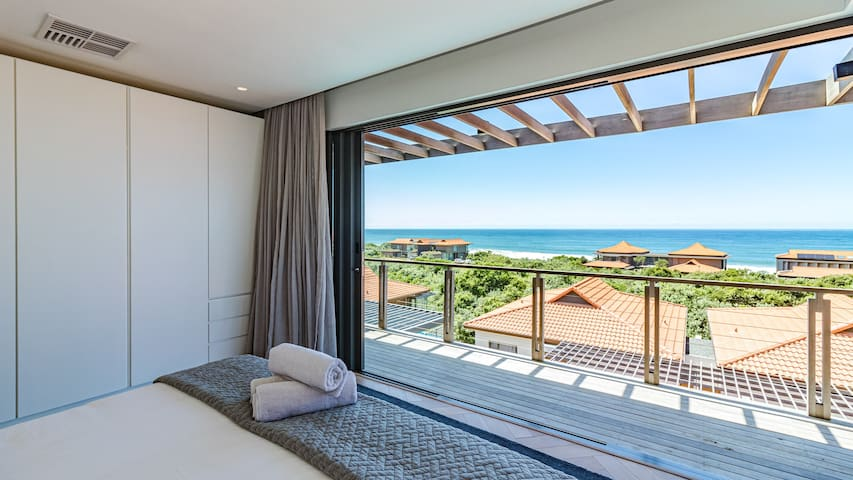 Master suite with wooden decked balcony and magnificent sea views