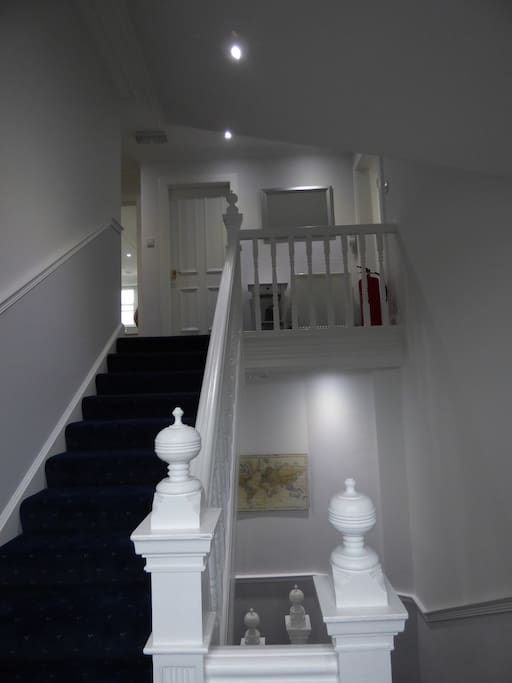 Staircase from front door , downstairs shower room and utility room to the main rooms