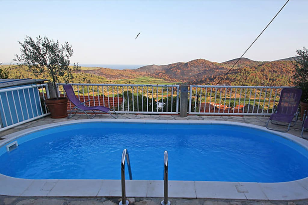 Pool with the view of the village and Adriatic Sea.