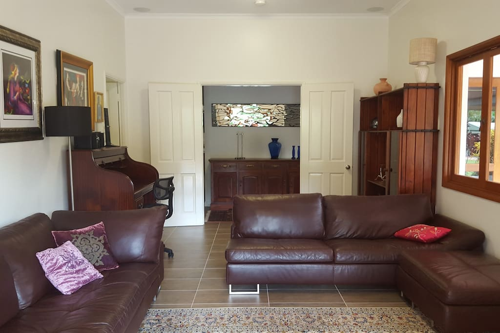 One of the lounge rooms, very comfortable, Natuzzi leather lounge, large LD Tv, DVD player, fully airconditioned, can be very private, has a desk and you can actually fall asleep on the couches or play chess