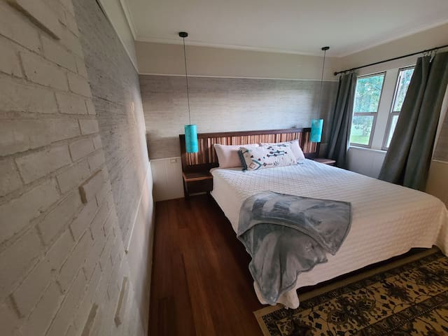Largest bedroom at 36 Oaks Retreat with King bed.