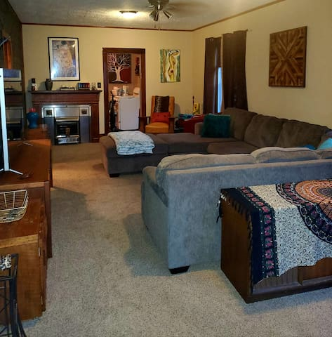 Living room. Large tv and wifi. Netflix availble.