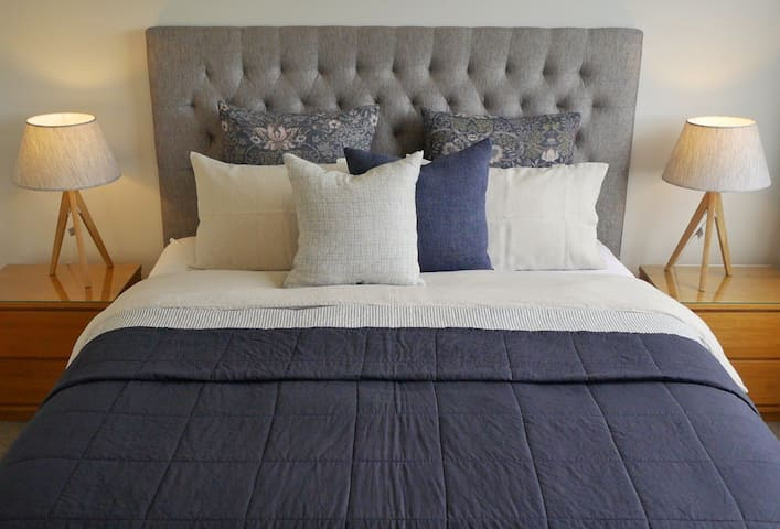 Comfortable superking bed with linen bedding.