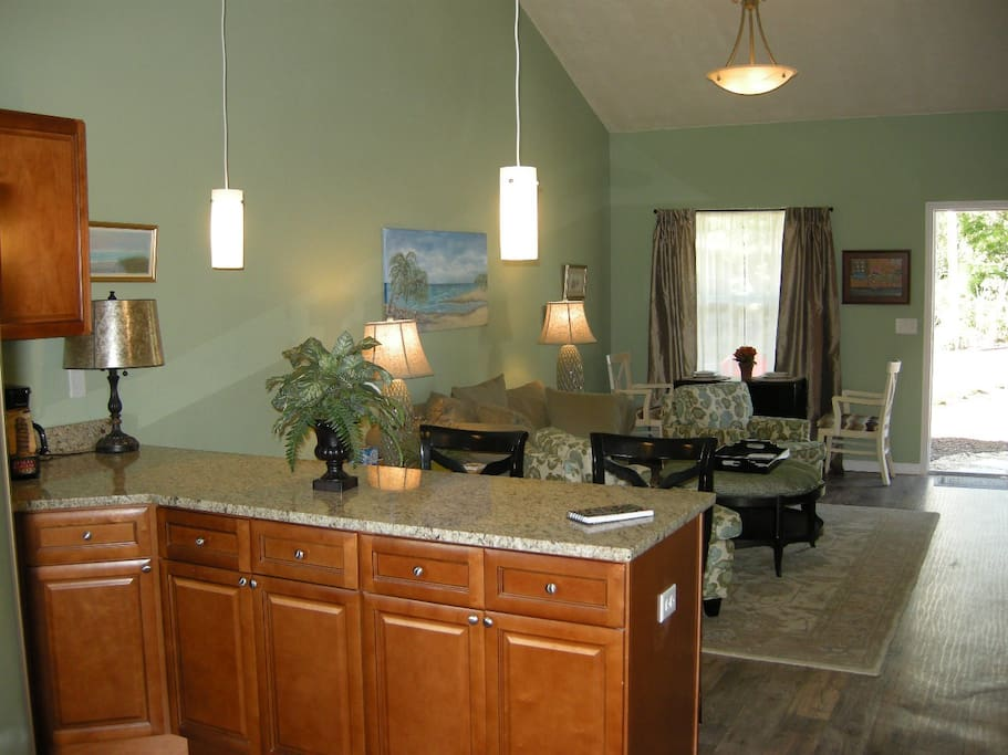 Open airy living, dining and kitchen