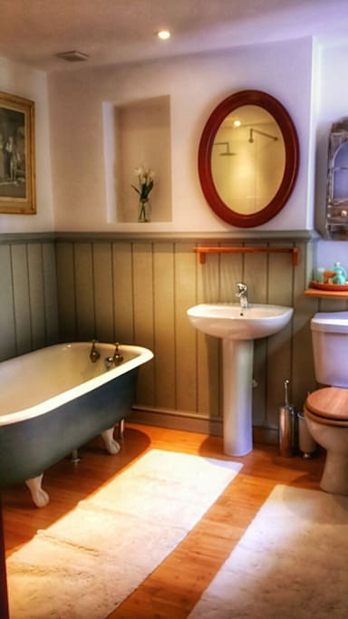 Your private bathroom with antique cast iron bath