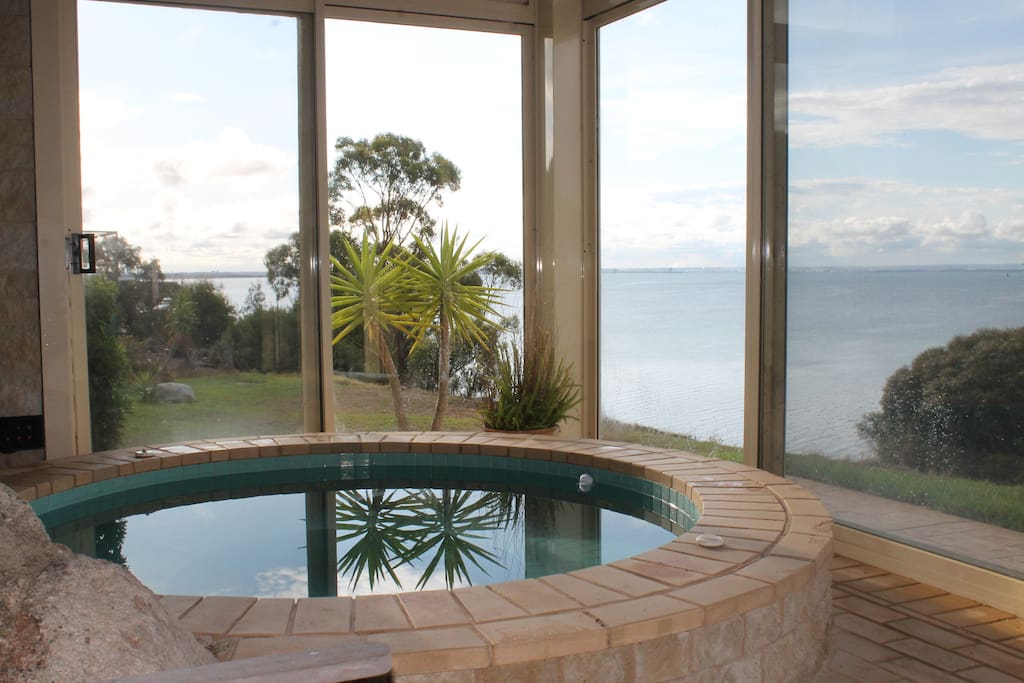 Indoor heated spa and pool with ocean views