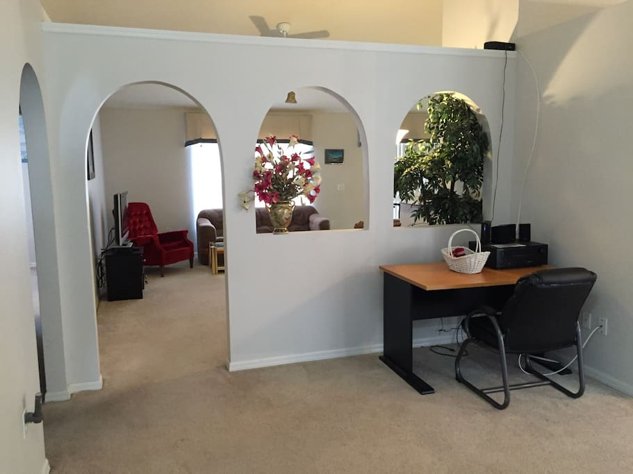 Entryway with a work desk station and Amplifier for attaching your device for a personal feel.