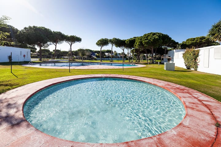 Air-conditioned Holiday Home with Pool Access, Garden and Terrace in a Golf area