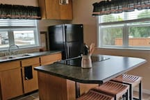 The kitchen is light and airy, with all new appliances and everything you'll need to cook your own meals and snacks.